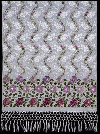 Image from object titled Scarf of Jacquard woven figured silk, England, ca. 1820.Scarf of Jacquard woven figured silk with a white ground, a pronounced rib and a pattern of roses and other flowers at each end in various...