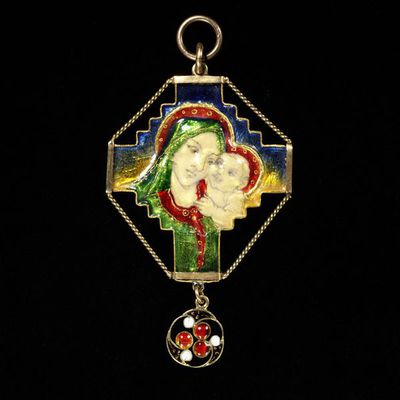 Pendant of enamelled gold, designed and made by Phoebe Traquair, Edinburgh, 1906.Pendant of gold with a double-sided enamelled representation of the Virgin and Child against a cross. Designed and made by Phoebe Anna...