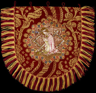 Embroidered cope hood, designed by A.W.N. Pugin, England, ca. 1848.Cope hood embroidered with the Martyrdom of St Thomas in the centre.Embroidered.