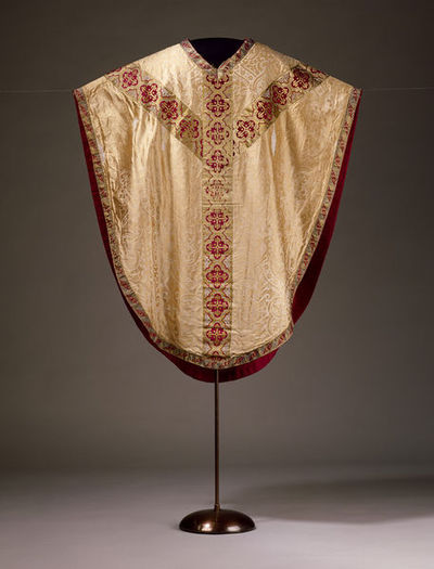 Vestments consisting of a chasuble, stole and maniple in silk damask, designed by A.W.N. Pugin, made in England, ca. 1848.Vestments consisting of a chasuble, stole and maniple in oyster silk damask.Silk damask.
