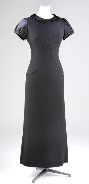Full length evening dress by Mary Quant, 1964. Black wool crepe with black silk collar and sleeves. Full length evening dress of black wool crêpe with black silk collar and sleeves.Wool crêpe and silk.