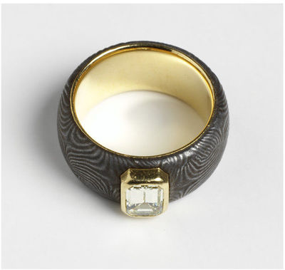 Section of steel shotgun barrel lined with gold and set with a yellow emerald-cut diamond. Steel supplied by Malcolm Appleby, ring designed and made by Roger Doyle. England, 1997. Wide band with convex section of polished...