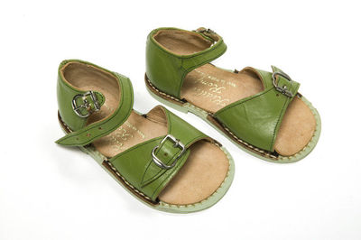 Image from object titled Green leather, Kiddie Komfort brand by S R Starling, made in England, 1950-9.