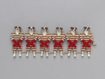 Image from object titled Bracelet of Jack Russells, Felieke van der Heest, Norway, 2008.Bracelet consisting of a line of six Jack Russell terriers standing on their hind legs and dressed in striped football kit. They are...