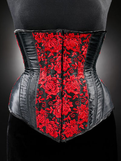 Image from object titled Embroidered satin corset, designed by Rigby & Peller, Great Britain, 1996.Black satin corset with red floral embroidery.Embroidered satin.