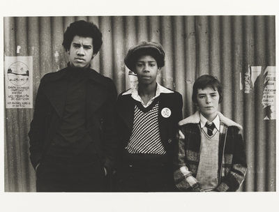 Image from object titled Untitled [three boys in descending height order, centre one with cloth cap] from the series On a Good Day