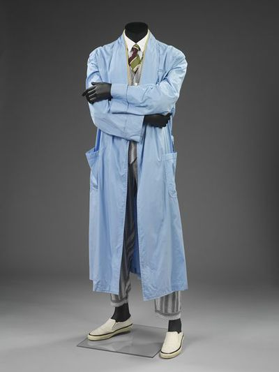 Suit ensemble, coat and belt, shirt, waistcoat, tie and trousers, and plimsols, Comme des Garçons, designed in France, made in Japan, 1995. Belt, light blue cotton, Comme des Garçons, designed in France, made in Japan,...