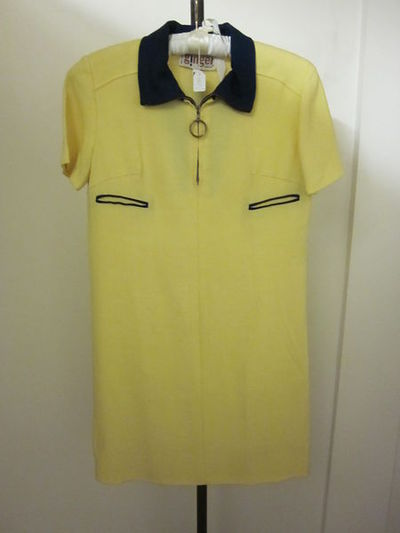 Mini-dress of cotton, designed by Mary Quant, Great Britain, 1960s.Mini-dress of yellow cotton with a blue neck.Cotton.