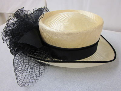 Woman's hat, cream top hat in ecru straw trimmed with pom tulle, velvet band, John Boyd, Great Britain, spring/summer 1996 collection.