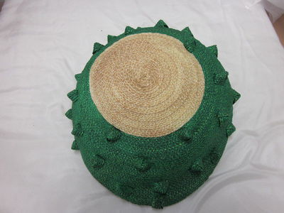 Straw hat, designed by Simone Mirman, London, 1959. Hat with an oatmeal straw crown extending into vibrant green straw, and accented with pyramidal knots of green straw. Straw.