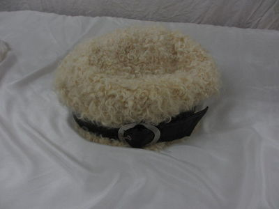Hat. Sheepskin `Donovan cap' with PVC buckle, by Simone Mirman, London, 1960s. Hat. Sheepskin `Donovan cap' with PVC buckle. Sheepskin, PVC.