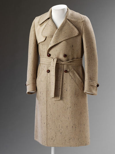 Man's overcoat of flecked pale brown wool with black and a sash belt, designed by Carlo Palazzi, Italy, 1969-1970.