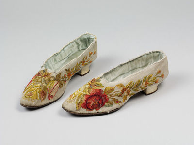 Pair of shoes made from machine-woven tapestry, woven by William Haines, England, ca. 1900.