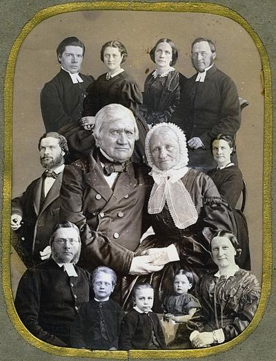 """Image from object titled Gruppbild , Wilhelmina Lagerholms familj. Fotomontage. Längst upp till vänster: Wilhelminas syster Sofia Nikolina """"Siffi"""" Ekström (1832-1903) gift med Albert Ekström, hovpredikant i Vingåker. Till höger: Wilhelminas syster Ingeborg Elisabeth Hildegard Bastholm (1830-1897) gift med kyrkoherde Johan Bastholm (1816-1892). I mitten föräldrarna: Anna Elisabeth (Ann Lisette) Lagerholm (född Ekman) och Nils Fredrik Wilhelm Lagerholm (1791-1866). Till vänster om pappan: Johan Fredrik Lagerholm (1834- ), Wilhelminas bror. Till höger om mamman: Wilhelmina Lagerholm. Längst fram: Wilhelminas bror, Per Didrik Lagerholm (1824-1875), kyrkoherde i Södertälje med första hustrun Juliana Christina Lagerholm, född Åstrand (1827-1864) och tre barn. Dottern heter Juliana Fredrika Lovisa (1862- , gift 1887 med Emil Magnus Ludvig Mannerfeldt)."""