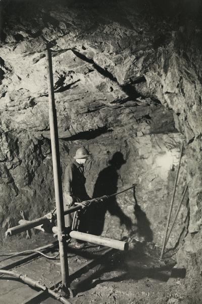 Image from object titled Outokumpu Oy:n kaivosmies työssään