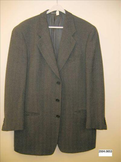 Jasje in donkergrijze tweed