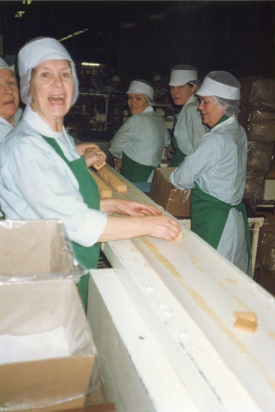 Group of workers packing biscuits into boxes | Jacob's Biscuit Factory