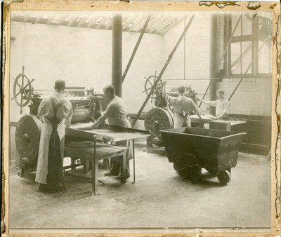 Image from object titled Bakers rolling the dough at Jacob's Biscuit Factory
