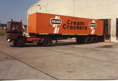 Large orange Jacob's truck with Cream Crackers advertised on its side | Jacob's Biscuit Factory