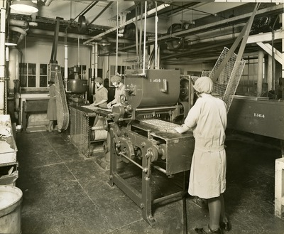Image from object titled Jacob's employees operating icing machines in Aintree