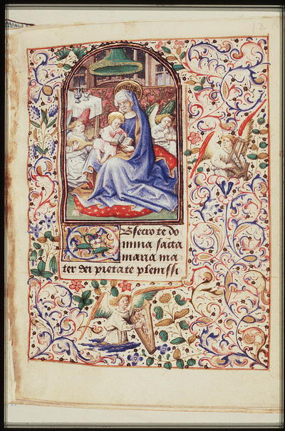 Mary sitting on the ground, reads to the Christ-child