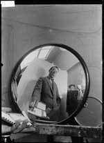 Self portrait in a mirror with Dick Elffers behind the camera (advertisement for cigarette brand Xanthia) (1928-1930)