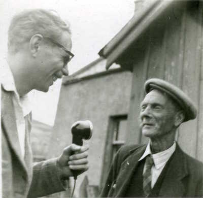 Hamish Henderson with an unknown male. Unknown location and date
