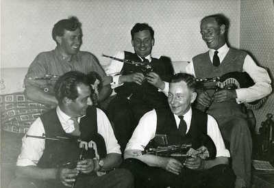 Bob Rundle, Jack Armstrong and Peter Kennedy with two unidentified men. Unknown location and date