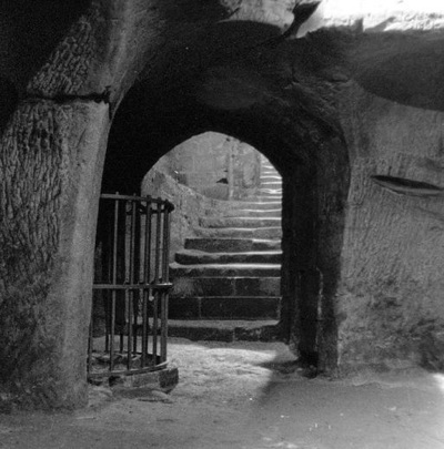 The cellars of the great hall looking towards the base of the steps; The magazine at Pontefract Castle