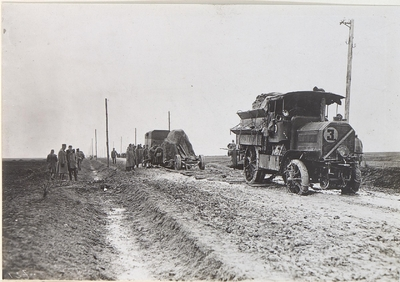 Image from object titled Pulling out a mortar vehicle with a towing car and chain