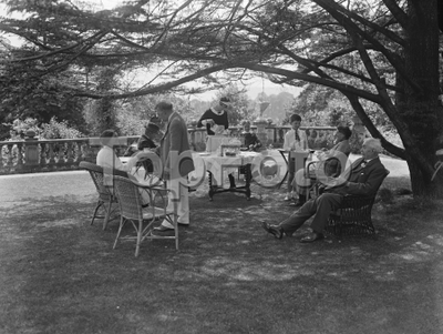 Image from object titled Afternoon tea in the gardens of Oakhill . 1928