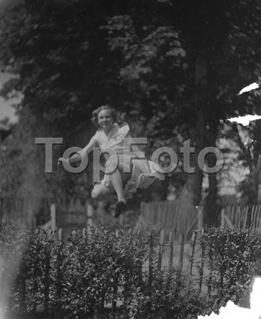 Miss D Topham jumping . 1935 .