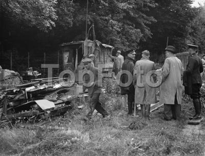 Watchers watch on as a shack in Kingsdown is demolished . 1936