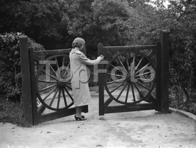 Gates fashioned from old wheels in Farnborough , Kent . 1938