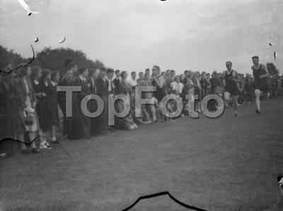 Sydney Wooderson , the great British middle distance runner and mile world record holder , teaches boys running technique .   1939