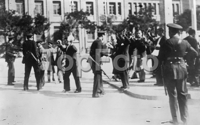 Civil guards search captured revolutionaries in Madrid , Spain  .  9 October 1934 .