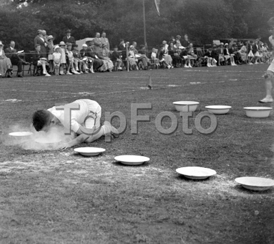 Merton Court sports day in Sidcup, Kent. Boys with face in flour.  1934