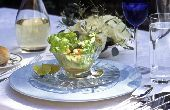 Image from object titled Seafood salad in crystal glass bowl in formal table setting outdoors  credit: Marie-Louise Avery / thePictureKitchen / TopFoto