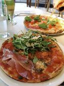 Pizzas in Pizza Express restaurant   credit: Marie-Louise Avery / thePictureKitchen / TopFoto