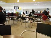 People waiting in coffee shop at Edinburgh airport  credit: Marie-Louise Avery / thePictureKitchen / TopFoto