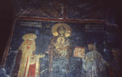 Image from object titled Church of the Agioi Anargyroi, Kastoria, Greece. Inner wall painting representing the Virgin holding the Christ child between the donor of the church Theodoros Lemniotes (right) and his wife Anna Radine (left)