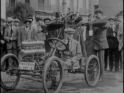 Image from object titled Romulo Bosch and Fabregat Brothers, from Barcelona, have invented a propeller-powered car. Driving through Barcelona. The vehicle is very light, two men can lift it. Proofs through the streets of...