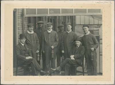 Image from object titled Photograph of Michael Tierney and others outside a coal mine.