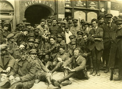 Image from object titled Irish Free State Army soldiers seated and standing in the street of a city or town