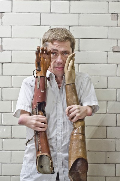 Image from object titled Mat Fraser holding two prosthetic arms at Blythe House