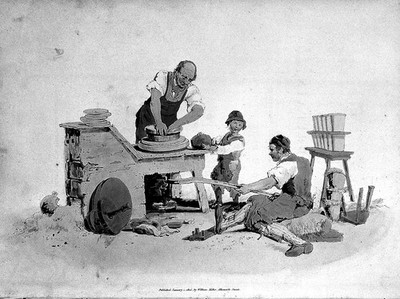 Image from object titled Child labour: boy helping at the pottery wheel.