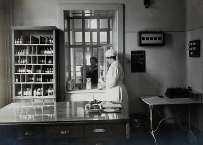 Image from object titled University Children's Hospital, Vienna: a female patient collects her drugs from the pharmacy in the out-patients' department. Photograph, 1921.