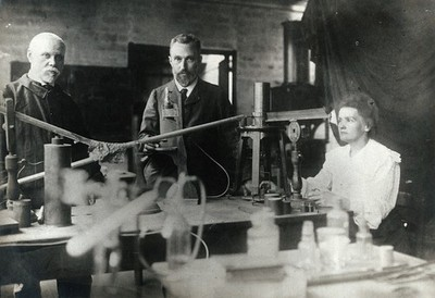 Image from object titled Marie and Pierre Curie (centre) in their laboratory, Paris