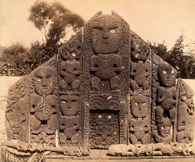 Image from object titled New Zealand: the carved front of a Maori meeting house. Albumen print.