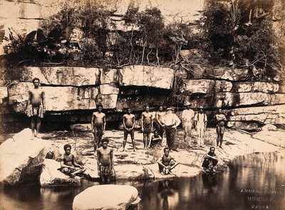 Image from object titled Eshowe, South Africa: a group of Africans at Adam's Mill. Albumen print by J. Wallace Bradley.